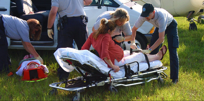 Scott County Ambulance Service EMTs assist accident victims as part of a training exercise.
