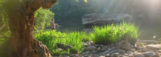 An angler fishes for smallmouth bass just off S.R. 297.